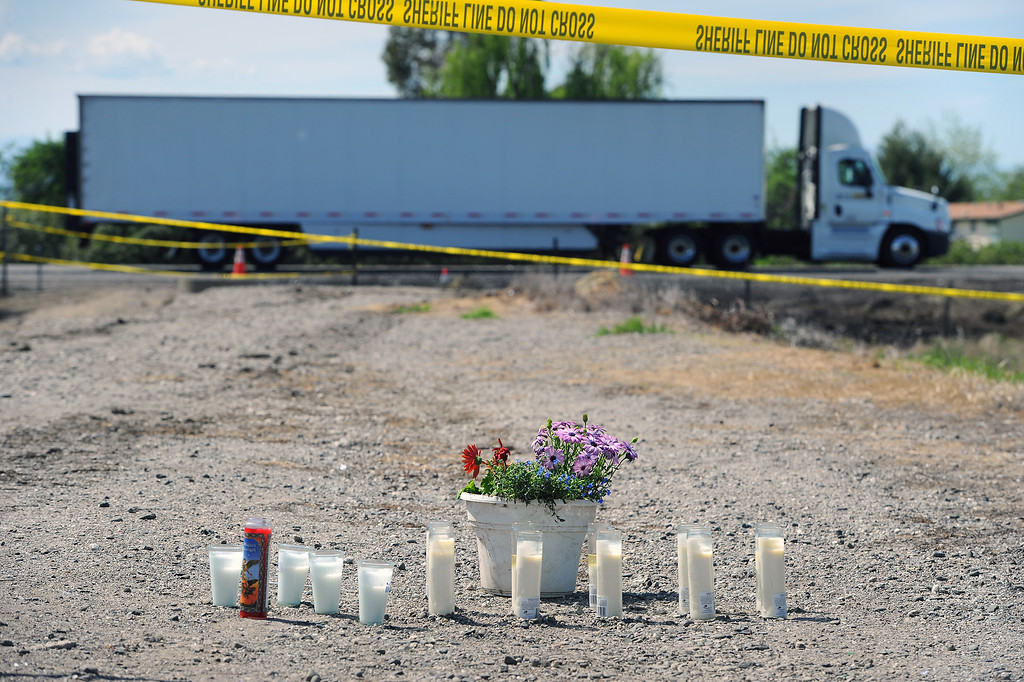 . Candles placed near the scene of the collision between the FedEx truck and the bus carrying high school students on the I-5, Friday, April 11, 2014, in Orland, Ca. (Photo by Michael Owen Baker/L.A. Daily News)