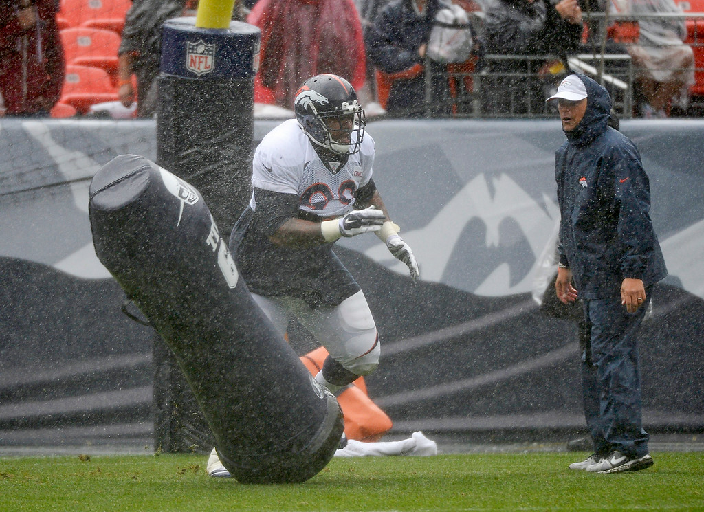 . Denver Broncos defensive tackle Kevin Vickerson (99) runs through drills during a rain day on day six of the Denver Broncos 2014 training camp July 30, 2014 at Sports Authority Field at Mile High Stadium.  (Photo by John Leyba/The Denver Post)