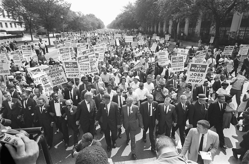 ". The clergyman and civil rights leader Martin Luther KIng (3rd from left) and other black and white civil right leaders march 28 August 1963 on the Mall in Washington DC during the ""March on Washington\"". King said the march was \""the greatest demonstration of freedom in the history of the United States.\"" AFP/Getty Images"