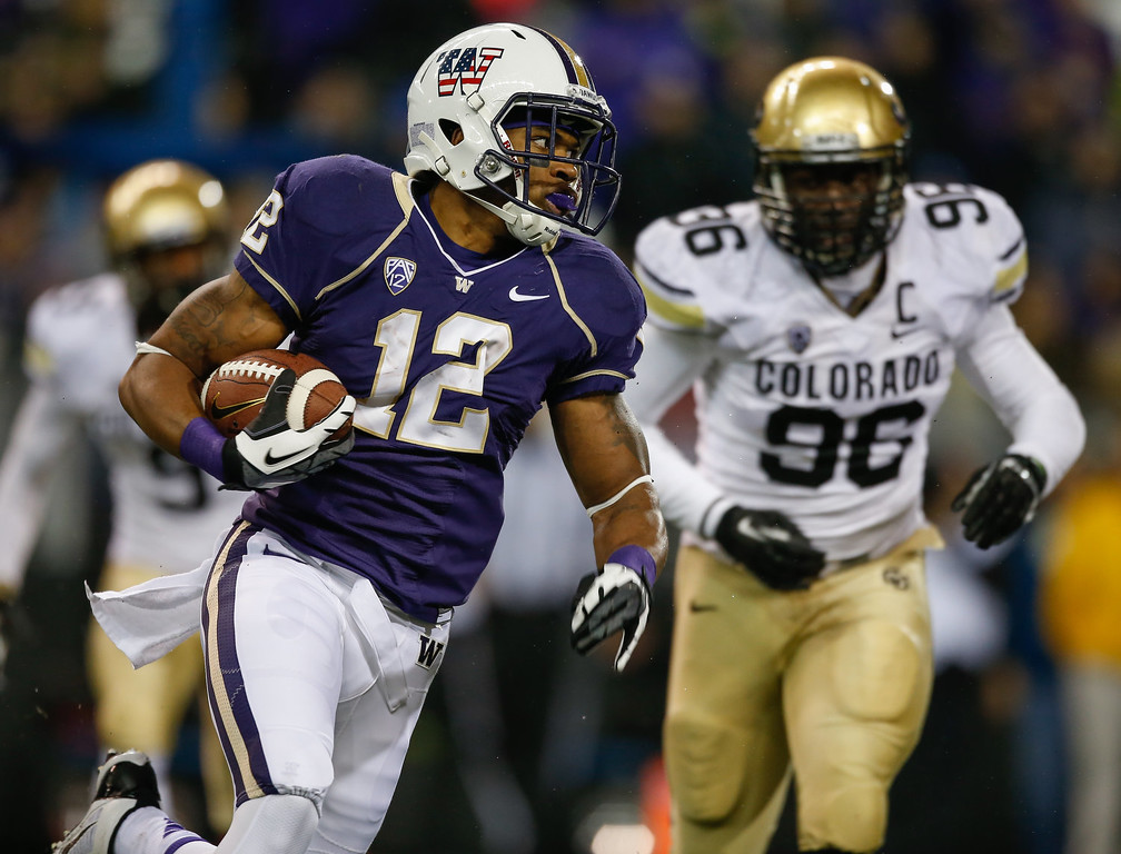 . Running back Dwayne Washington #12 of the Washington Huskies rushes for a touchdown in the fourth quarter against the Colorado Buffaloes on November 9, 2013 at Husky Stadium in Seattle, Washington. The Huskies defeated the Buffaloes 59-7.  (Photo by Otto Greule Jr/Getty Images)