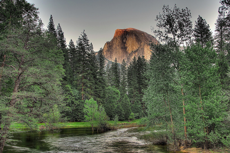 Iconic Half Dome rising above the Merced River