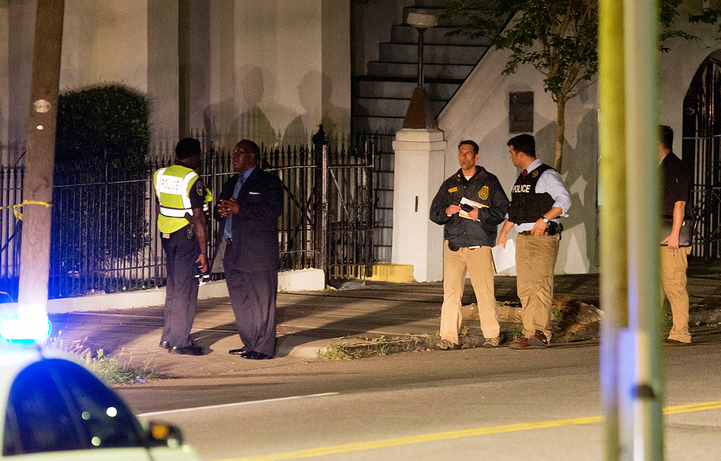 . Police stand outside the Emanuel AME Church following a shooting Wednesday, June 17, 2015, in Charleston, S.C. (AP Photo/David Goldman)