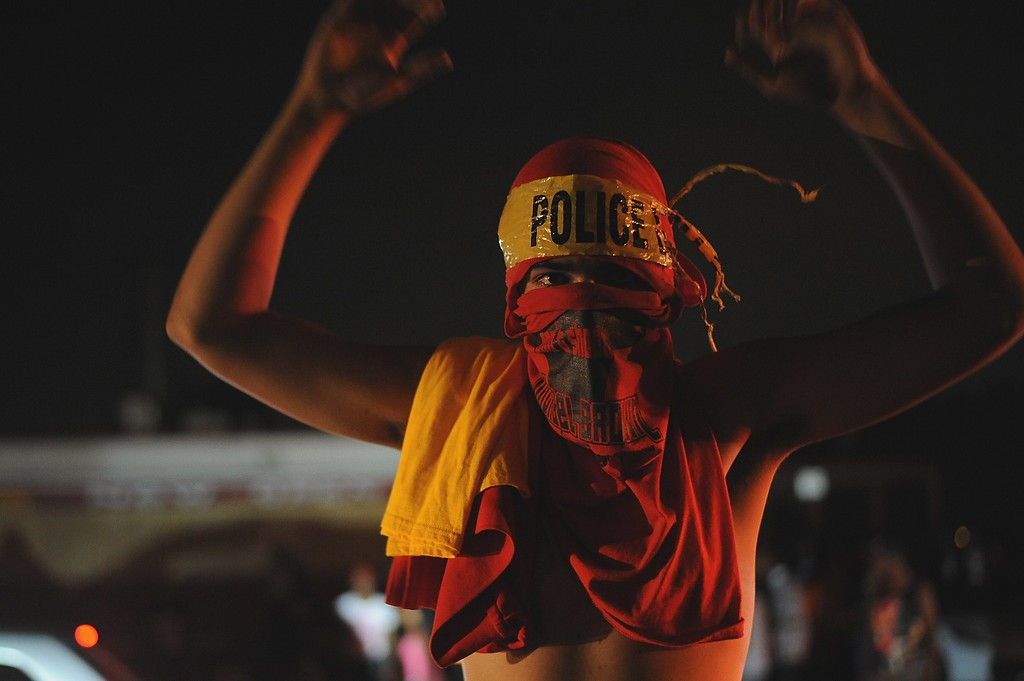 . Protestors demonstrate in Ferguson on August 17, 2014. Riot police hurled tear gas and marched on rioters in Ferguson, the St Louis suburb wracked by race riots since police shot dead an unarmed black teenager on August 9.  AFP PHOTO /  Michael B. Thomas/AFP/Getty Images