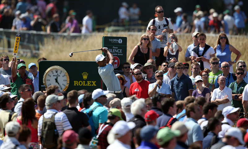 . US golfer Tiger Woods tees off on the 14th during the second round of the 2013 British Open Golf Championship at Muirfield golf course at Gullane in Scotland on July 19, 2013 . ADRIAN DENNIS/AFP/Getty Images