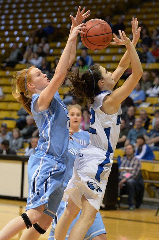 . Broomfield\'s Brenna Chase has the ball knocked away by Valor Christian\'s Madison McCoy during the final four 4A state game at Coors Event Center. (David R. Jennings/Broomfield Enterprise)