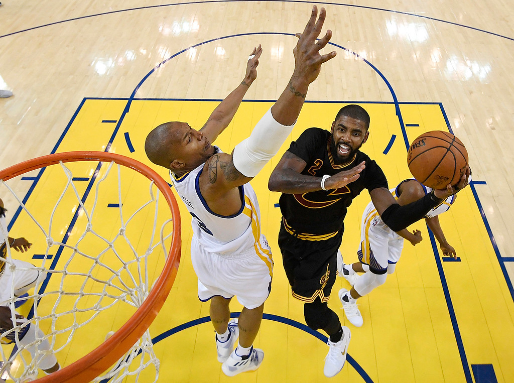 . Cleveland Cavaliers guard Kyrie Irving, right, shoots against Golden State Warriors forward David West during the second half of Game 2 of basketball\'s NBA Finals in Oakland, Calif., Sunday, June 4, 2017. (Kyle Terada/Pool Photo via AP)