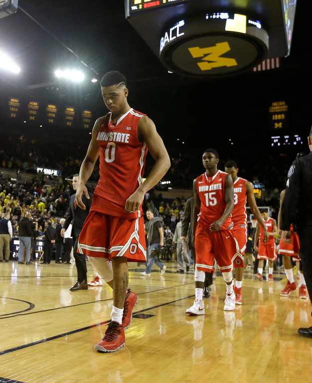 . Ohio State guard D\'Angelo Russell walks off the court after the second half of an NCAA college basketball game against Michigan, Sunday, Feb. 22, 2015 in Ann Arbor, Mich. Michigan defeated Ohio State 64-57. (AP Photo/Carlos Osorio)