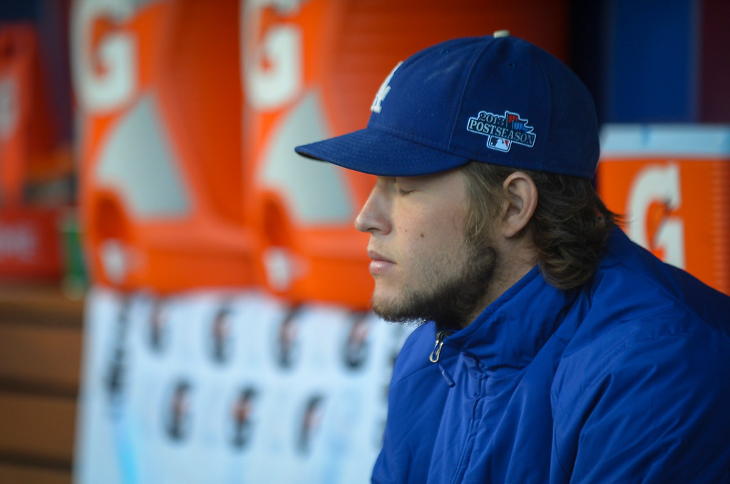 . The Dodgers\' Clayton Kershaw waits on the bench before the start of game 4 of Dodgers vs Atlanta Monday, October 7, 2013 ( Photo by Andy Holzman/Los Angeles Daily News )