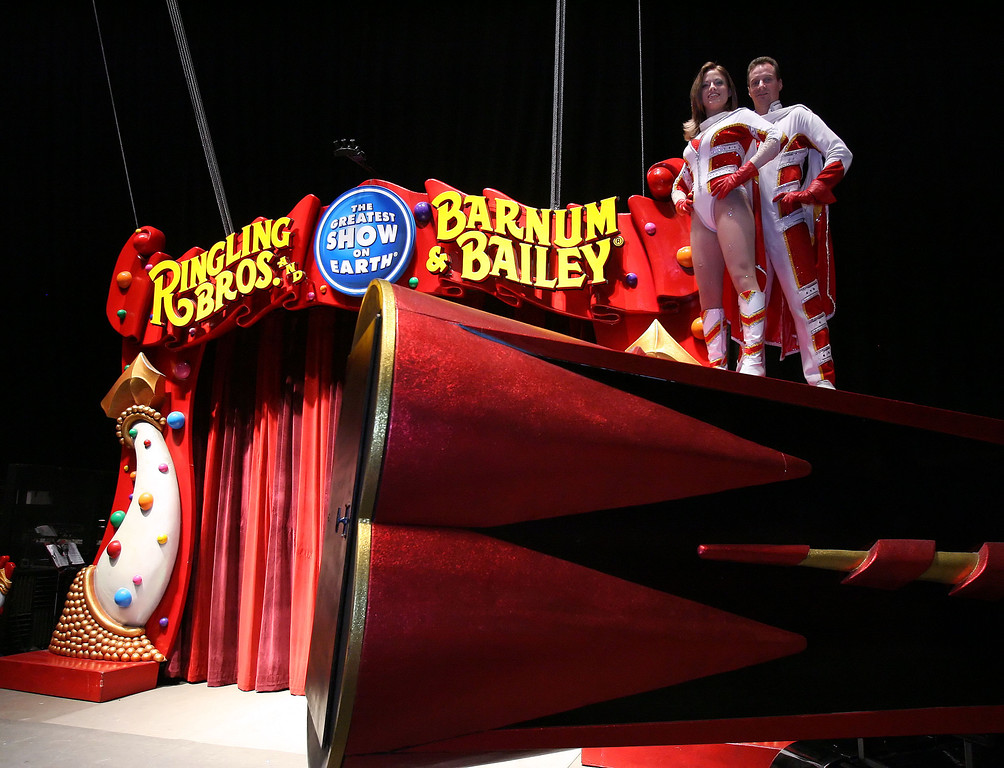. ** ADVANCE FOR WEEKEND EDITIONS AUG 19-20 ** Tina and Brian Miser stand atop their double-barreled cannon Thursday, Aug. 10, 2006, at the Fort Worth Convention Center in Fort Worth, Texas. The husband and wife team are human cannonballs for the Ringling Bros. Barnum & Bailey Circus. The circus opens Aug. 24 in North Little Rock, Ark. (AP Photo/D.J. Peters)