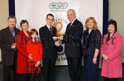 Padraig Mulholland a past pupil of St Coleman's College, Newry is congratulated by Gavin Boyd, CCEA Chief Executive, his parents and sister Maire (pictured left) and teacher Eva Freeburn and Head of Department Patricia Kelly (pictured right) on achieving joint first place in Art & Design in CCEA's summer 2006 A level examinations.