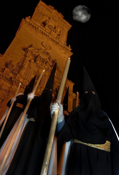 Nazarenos celebrating easter week in the Andalusian town of Arcos de la frontera.  Cadiz, Spain.