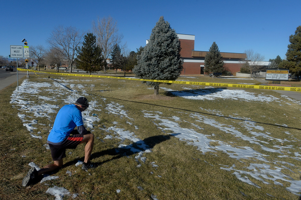 """. Sean Sweeney stops during a morning drive to say a prayer at Arapahoe High School in Centennial, CO December 14, 2013. He said,\""""I wanted to say a prayer for the community, the shooter and the victims. I hope teens learn from this. I just wanted to say a prayer.\""""   (Photo By Craig F. Walker / The Denver Post)"""