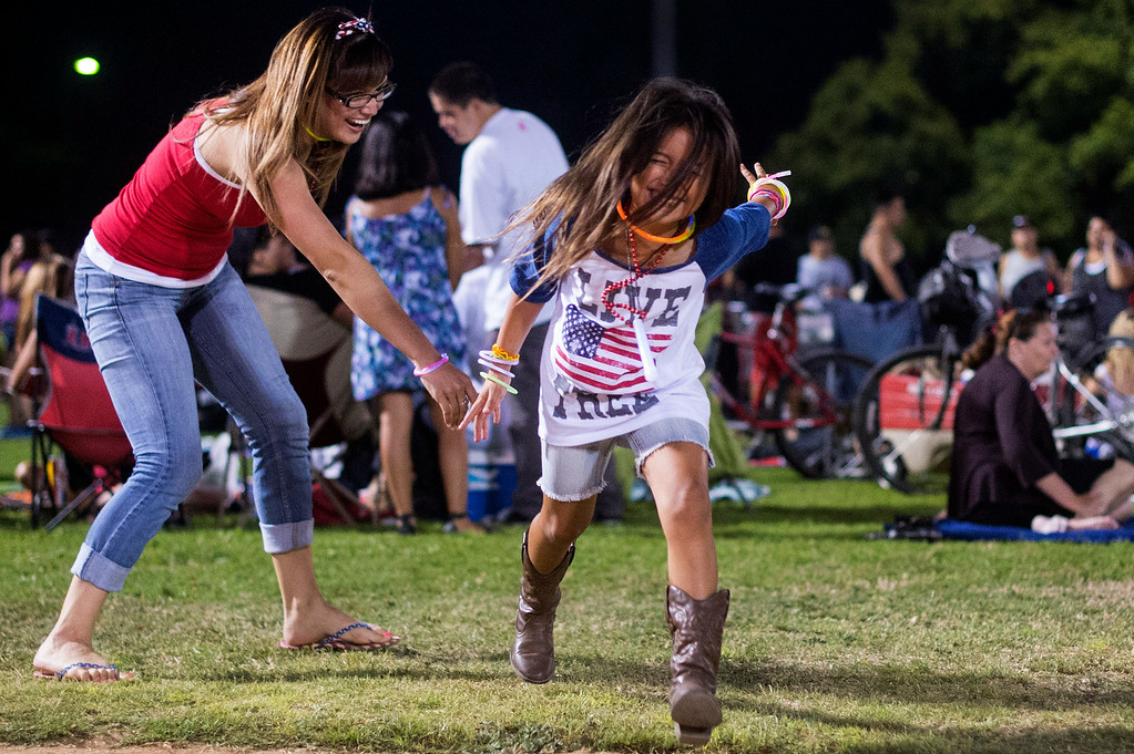 """. \""""It\'s tradition to see the fireworks on the 3rd of July. My parents too me now I take her,\"""" says Jennifer Duran who plays tag with her 6-year-old daughter Ryan Holmen before La Mirada\'s annual fireworks show Thursday night, July 3, 2014 at La Mirada Regional Park. (Photo by Sarah Reingewirtz/Pasadena Star-News)"""