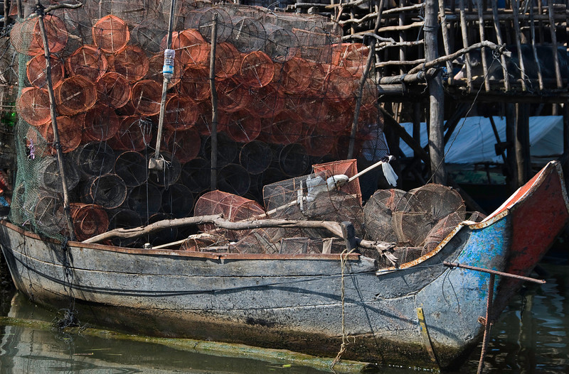 Working fishing boat, with traps.