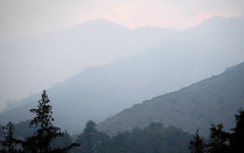 . Smoke hangs on the ridges of Big Sur as firefighters battle a fire in the Pfeiffer Ridge area on Tuesday December 17, 2013. (Photo David Royal/ Monterey County Herald)