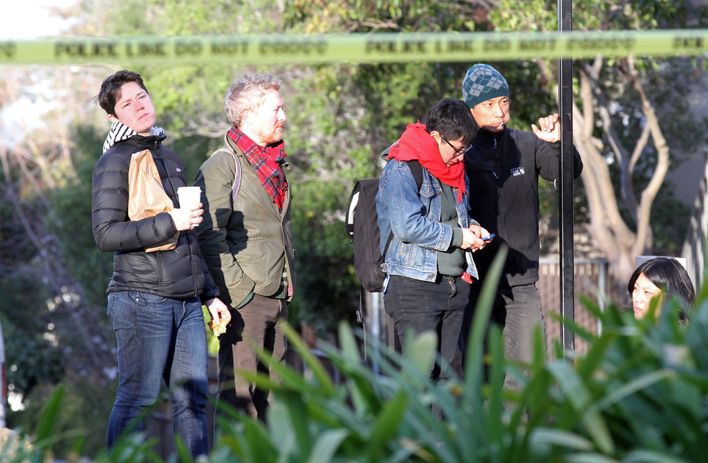 . Employees of the restaurant Chez Panisse wait on the other side of the street awaiting word of the amount of damage caused by an early morning fire at the restaurant in Berkeley, Calif. on Friday , March 8, 2013.(Laura A. Oda/Staff)