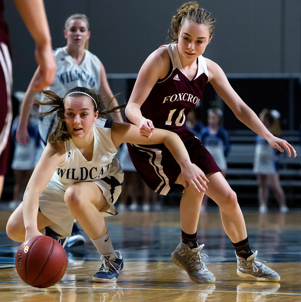 BANGOR, Maine -- 02/22/2017 -- Presque Isle's Emily A. Wheaton (left) and Foxcroft Academy's Abbi Bourget battle for a loose ball during their Class B girls basketball semifinal game at the Cross Insurance Center in Bangor Wednesday. Ashley L. Conti | BDN