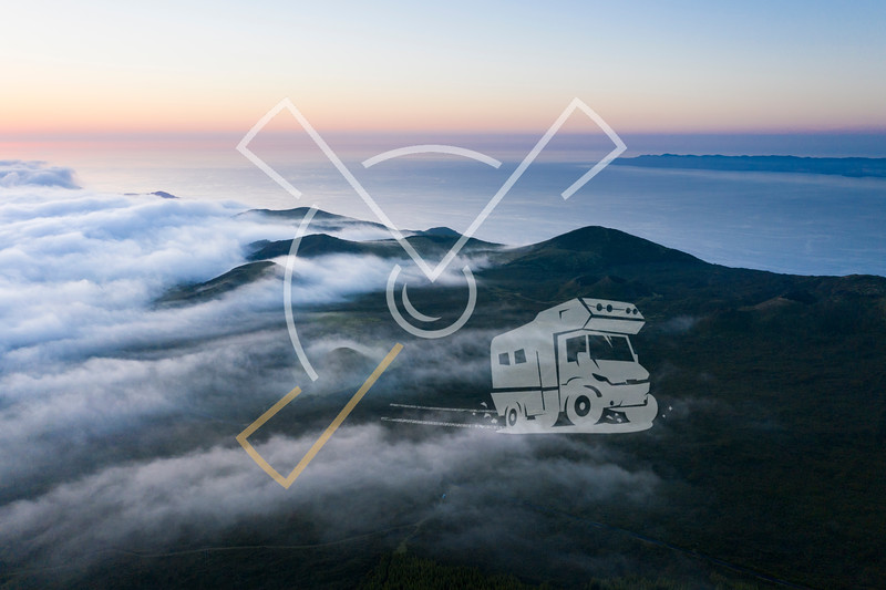 Aerial image with magical sunset over a low cloud layer covering Pico Island, with the northcoast and Sao Jorge Island in the background, Azores