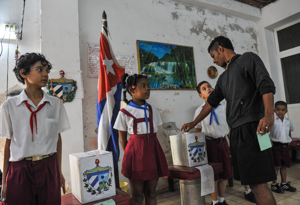 Description of . A Cuban casts his vote at a polling station in Havana on February 3, 2013. Cubans on Sunday elected provincial delegates to to the People's Power assemblies and parliamentary deputies. AFP PHOTO / STR/AFP/Getty Images