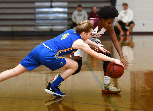 12/31/2019 MIke Orazzi | StaffrBristol Central's Damani Hough (2) and Gilbert's Kim McCarthy (4) during Tuesday's girls basketball game in Bristol. rr