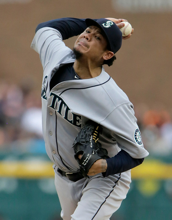 . Seattle Mariners\' Felix Hernandez pitches against the Detroit Tigers during the first inning of a baseball game Saturday, Aug. 16, 2014, in Detroit. (AP Photo/Duane Burleson)
