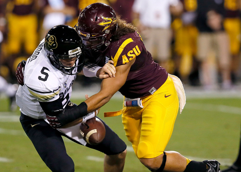 . Arizona State\'s Carl Bradford, right, causes Colorado\'s Connor Wood (5) to fumble the ball during the first half of an NCAA college football game on Saturday, Oct. 12, 2013, in Tempe, Ariz. Colorado recovered the ball. (AP Photo/Ross D. Franklin)