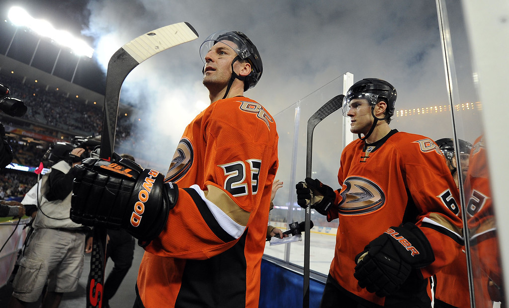 . Anaheim Ducks defenseman Francois Beauchemin (23) walks off the ice with his teammates after defeating the Los Angeles Kings 3-0 and bing named one of the stars of the game during the inaugural NHL Stadium Series game at Dodger Stadium in Los Angeles on Saturday, Jan. 25, 2014. (Keith Birmingham Pasadena Star-News)