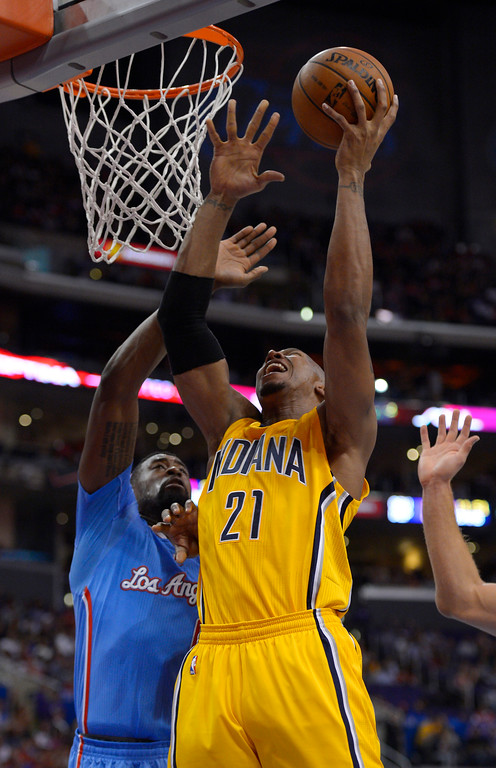 . Indiana Pacers forward David West, right, puts up a shot as Los Angeles Clippers center DeAndre Jordan defends during the first half of an NBA basketball game, Sunday, Dec. 1, 2013, in Los Angeles. (AP Photo/Mark J. Terrill)