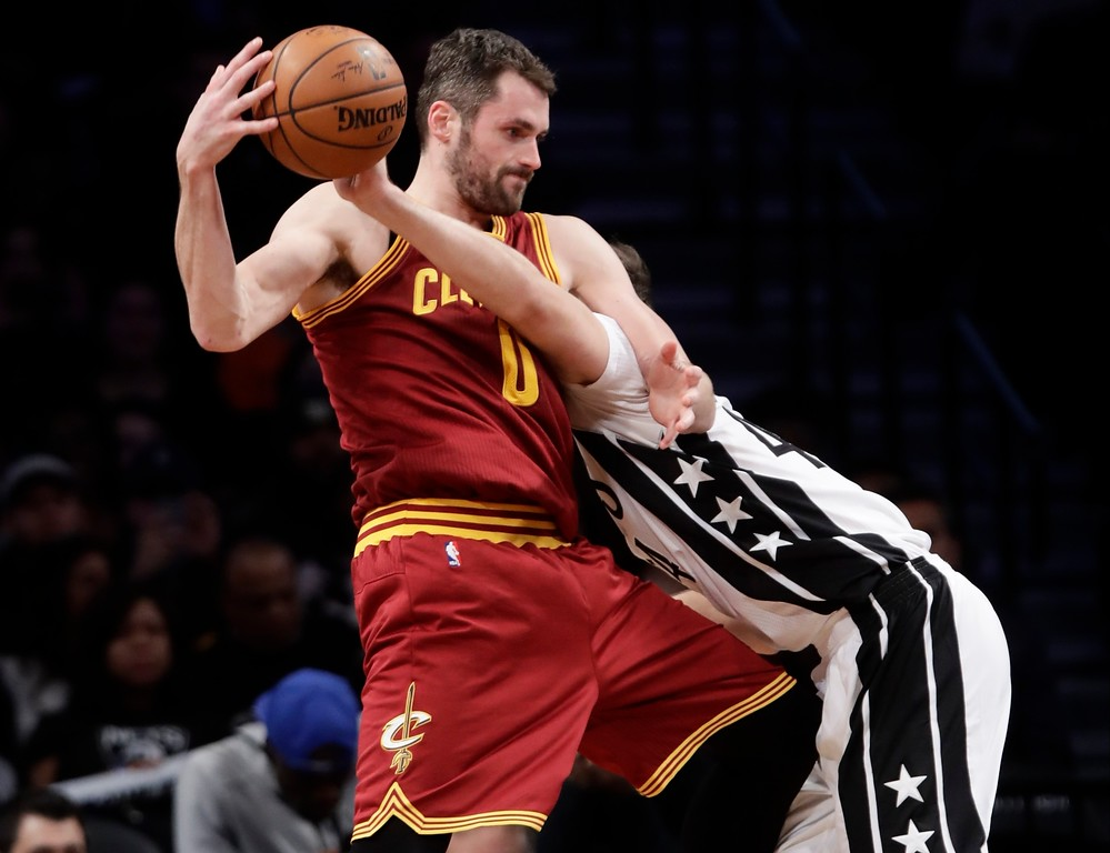 . Cleveland Cavaliers\' Kevin Love (0) is fouled by Brooklyn Nets\' Bojan Bogdanovic (44) during the second half of an NBA basketball game Friday, Jan. 6, 2017, in New York. The Cavaliers won 116-108. (AP Photo/Frank Franklin II)