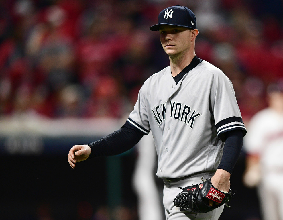. New York Yankees starting pitcher Sonny Gray walks to the dugout after being pulled during the fourth inning against the Cleveland Indians in Game 1 of a baseball American League Division Series, Thursday, Oct. 5, 2017, in Cleveland. Gray pitched 3 1/3 innings and gave up three hits and three runs. (AP Photo/David Dermer)