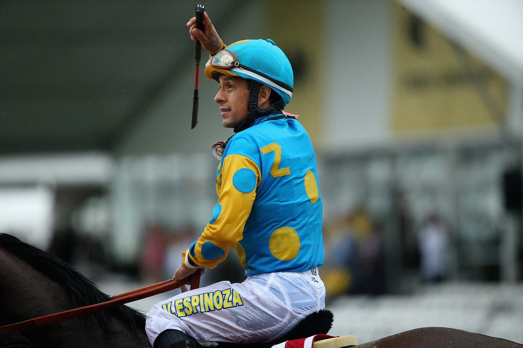 . American Pharoah #1 ridden by Victor Espinoza acknowledges the crowd after winning the 140th running of the Preakness Stakes at Pimlico Race Course on May 16, 2015 in Baltimore, Maryland.  (Photo by Patrick Smith/Getty Images)