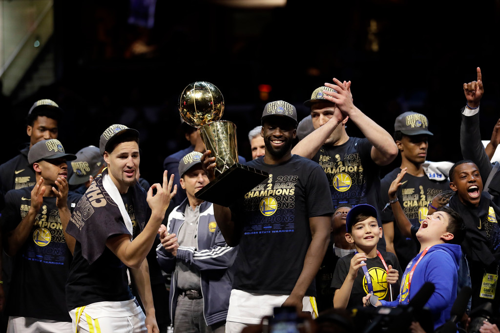 . Golden State Warriors\' Draymond Green celebrates after the Warriors defeated the Cleveland Cavaliers 108-85 in Game 4 of basketball\'s NBA Finals to win the NBA championship, Friday, June 8, 2018, in Cleveland. (AP Photo/Tony Dejak)