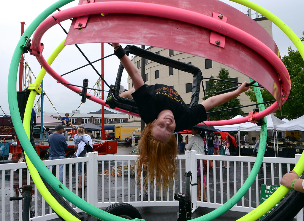 . Ellie Schreiner ,11, enjoys a spin on a Orbotron during the Lansdale Founders Day  celebration and on Saturday August 23,2014. Photo by Mark C Psoras/The Reporter