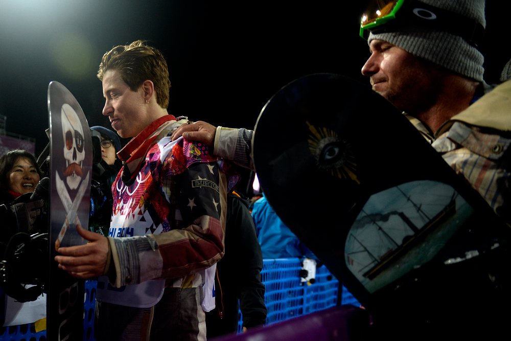. Shaun White reacts as longtime trainer Bud Keene places a hand on his shoulder after the two-time defending gold medalist finished fourth in the men\'s snowboard halfpipe final. Sochi 2014 Winter Olympics on Tuesday, February 11, 2014. (Photo by AAron Ontiveroz/The Denver Post)