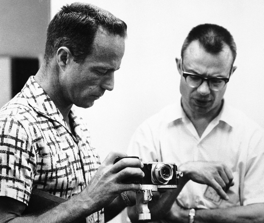 . Astronaut Scott Carpenter looks over the 35mm German made Robot camera he?ll hold in his hand to make pictures on his orbital flight scheduled for Thursday. With Carpenter, May 22, 1962 at his Cape Canaveral training quarters is Dr. Robert B. Voas, the astronauts? training physician. (AP Photo)
