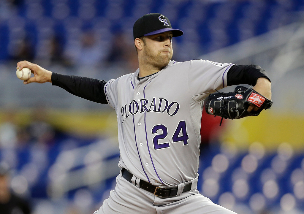 . Colorado Rockies starting pitcher Jordan Lyles throws in the first inning of a baseball game against the Miami Marlins, Wednesday, April 2, 2014, in Miami. (AP Photo/Lynne Sladky)