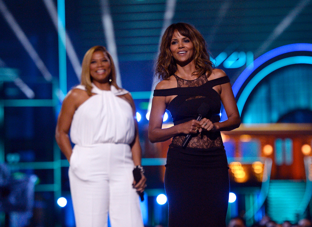 . Queen Latifah, left, and Halle Berry present the generation award at the MTV Movie Awards at Warner Bros. Studio on Saturday, April 9, 2016, in Burbank, Calif. (Kevork Djansezian/Pool Photo via AP)