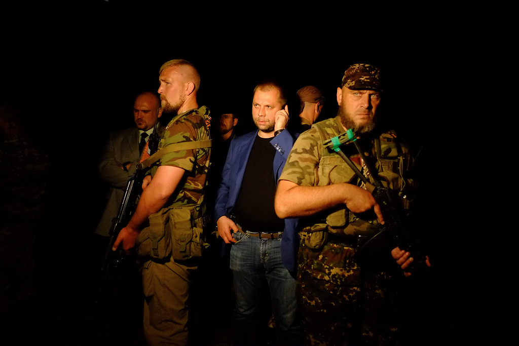 ". Self-proclaimed Prime Minister of the pro-Russian separatist ""Donetsk People\'s Republic\"" Alexander Borodai (C) stands as he arrives on the site of the crash of a malaysian airliner carrying 298 people from Amsterdam to Kuala Lumpur, near the town of Shaktarsk, in rebel-held east Ukraine, on July 17, 2014. The plane was shot down over Ukraine by a surface-to-air missile Thursday but it was unclear who fired the weapon, US officials said. AFP PHOTO/DOMINIQUE FAGET/AFP/Getty Images"