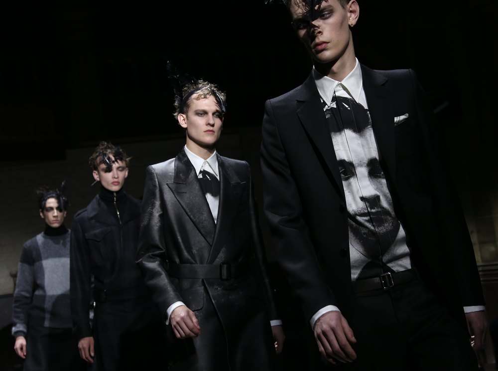 . A model wears a design during the Alexander McQueen show during London Collections for Men Autumn/Winter 2014, at the Welsh Chapel in central London, Tuesday, Jan. 7, 2014. (Joel Ryan/Invision/AP)