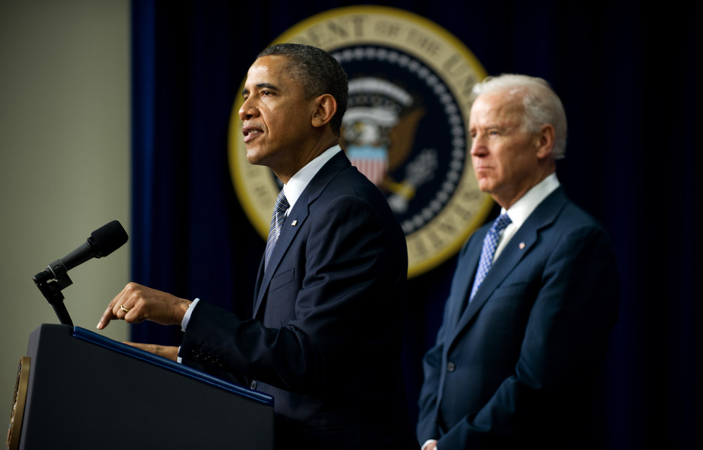 Description of . US President Barack Obama (L) speaks with Vice President Joe Biden during an event unveiling a package of proposals to reduce gun violence at the White House in Washington, DC, January 16, 2013. Obama signed 23 executive orders to curb gun violence and demanded Congress pass as assault weapons ban, in  a sweeping set of measures in response to the Newtown massacre.               AFP Photo/Jim  WATSON/AFP/Getty Images