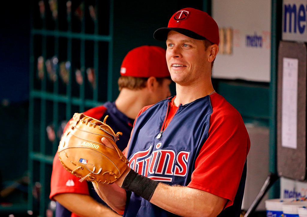 . Infielder Justin Morneau #33 of the Minnesota Twins watches batting practice just before the start of the game against the Tampa Bay Rays on July 8, 2013 in St. Petersburg, Florida.  (Photo by J. Meric/Getty Images)