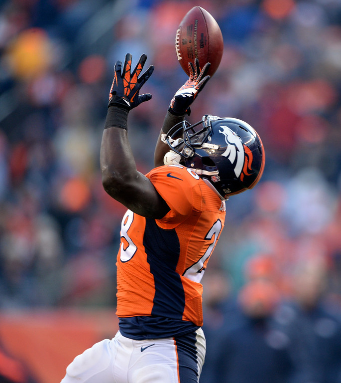 . DENVER, CO - DECEMBER 8: Denver Broncos running back Montee Ball (28) goes for a catch and misses during the first half.  The Denver Broncos vs. the Tennessee Titans at Sports Authority Field at Mile High in Denver on December 8, 2013. (Photo by Hyoung Chang/The Denver Post)