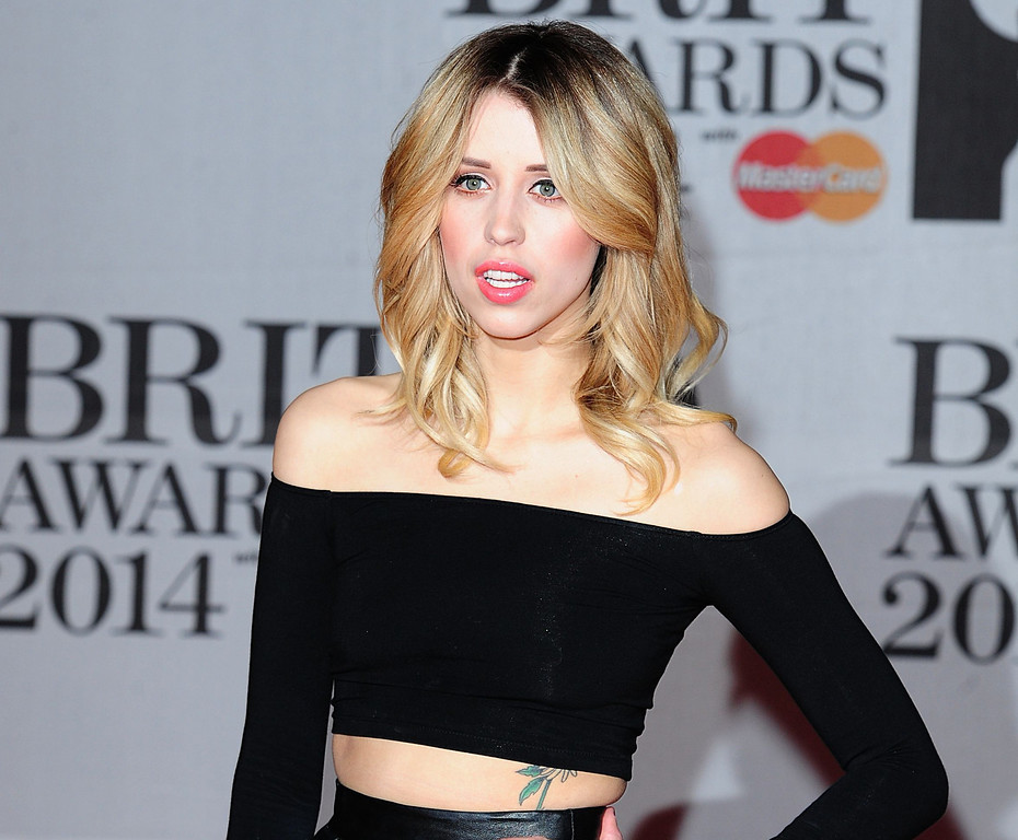 """. In this Feb. 19, 2014 file photo Peaches Geldof, daughter of Bob Geldof is seen at the Brit Awards 2014, in London. Peaches Geldof, the model and television presenter who was concert organizer Bob Geldof\'s daughter, has died at age 25. Bob Geldof said in a statement Monday, April 7, 2014: \""""Peaches has died. We are beyond pain.\"""" (AP Photo/PA, Ian West, File)"""