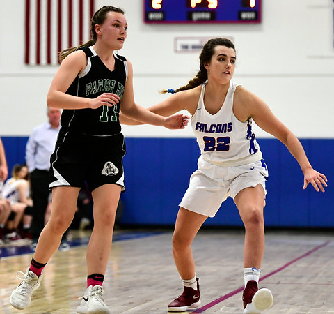 2/28/2019 Mike Orazzi | Staff St. Paul Girls Basketball's Morgan Kolb (22)and Parish Hill's Maggie Bolduc (11) during the Class S Second Round State Girls Basketball Tournament in Bristol Thursday night.