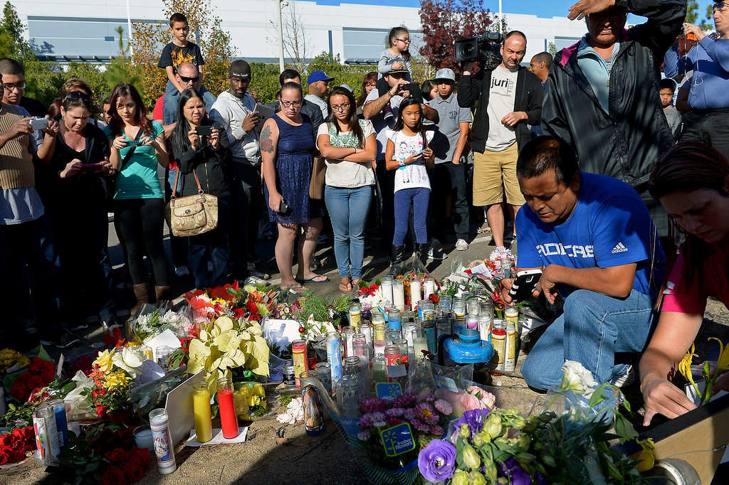 . People look at a memorial for Paul Walker and Roger Rodas, Sunday, December 1, 2013, at the scene of their fatal crash site in Valencia. (Photo by Michael Owen Baker/L.A. Daily News)