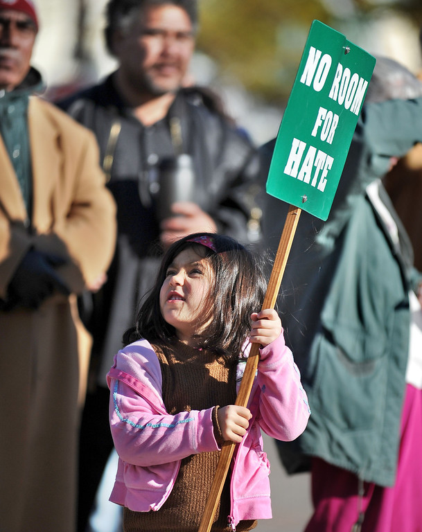 . Sophia Ireland, 5, of Hayward, holds a sign during the 10th annual interfaith Martin Luther King Jr. Day march and rally held in Hayward, Calif., on Monday, Jan. 21, 2013. The rally, held at the Hayward City Hall Plaza, featured words of King and music from the First United Methodist Church of Hayward, the First Tongan United Methodist of San Bruno and Congregation Shir Ami of Castro Valley.  (Doug Duran/Staff)