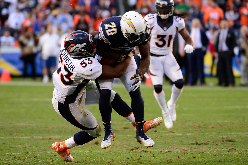 . SAN DIEGO, CA. December 14, - middle linebacker Steven Johnson #53 of the Denver Broncos makes a big hit on cornerback Chris Davis #20 of the San Diego Chargers at Qualcomm Stadium December 14, 2014 San Diego, CA (Photo By Joe Amon/The Denver Post)