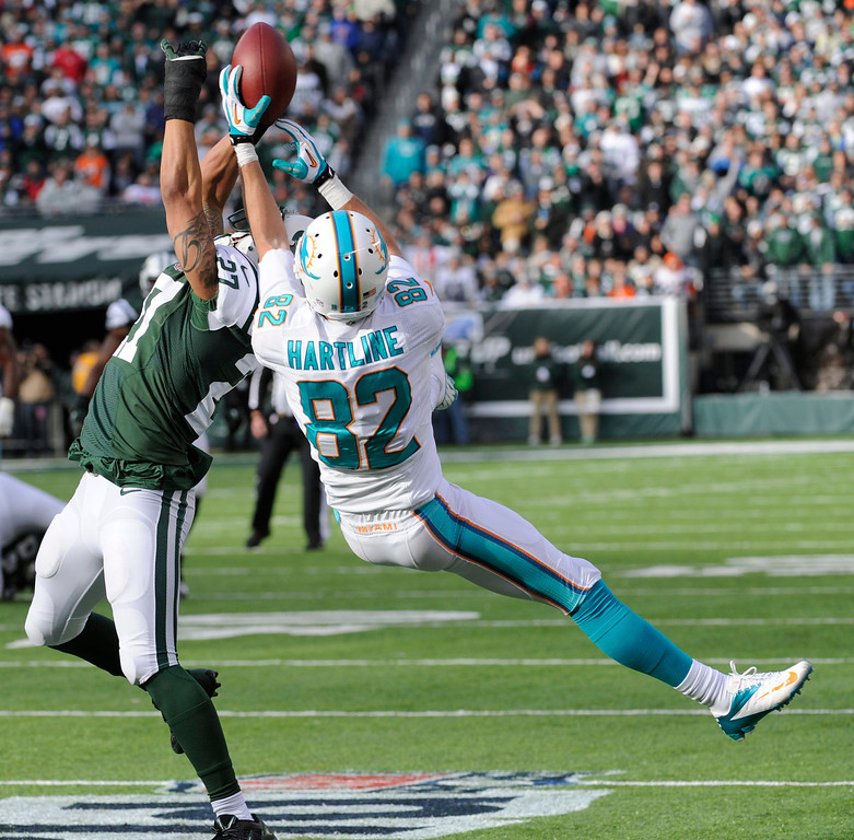 . New York Jets cornerback Dee Milliner (27) breaks up a pass intended for Miami Dolphins wide receiver Brian Hartline (82) during the first half of an NFL football game, Sunday, Dec. 1, 2013, in East Rutherford, N.J. (AP Photo/Bill Kostroun)