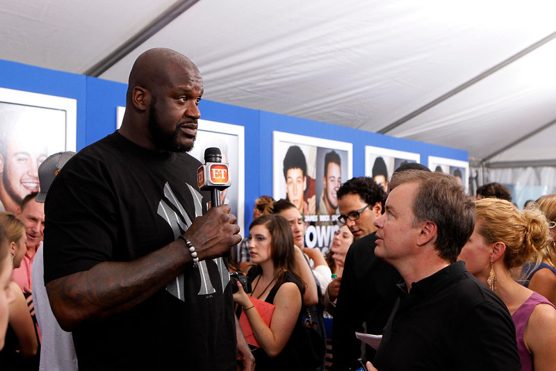 """. Former NBA star Shaquille O\'Neal holds is interviewed as he arrives for the premiere of the film \""""Grown Ups 2\"""" in New York, July 10, 2013.  REUTERS/Lucas Jackson"""
