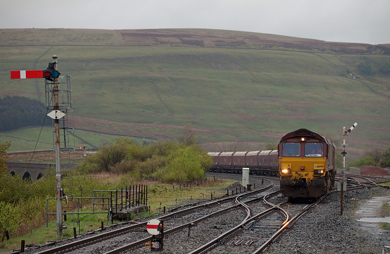 EWS 66099 with the 6E68 15:23 New Comnock - Drax Powerstation EWS loaded coal in Garsdale.